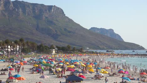 A-crowded-and-busy-holiday-beach-scene-at-Camps-Bay-Cape-Town-South-Africa-with-Twelve-Apostles-mountains-background-4