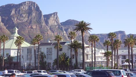 The-Twelve-Apostle-mountains-and-Table-Mountain-tower-above-hotels-and-apartments-at-Camps-Bay-Cape-Town-South-Africa