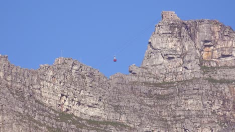 A-cable-car-ascends-to-Table-Mountain-overlooking-Cape-Town-South-Africa