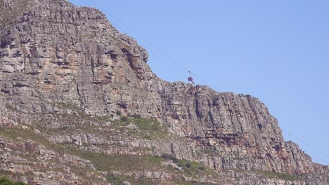 A-cable-car-ascends-to-Table-Mountain-overlooking-Cape-Town-South-Africa-1