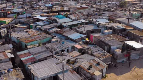 Aerial-over-ramshackle-tin-roofs-of-Gugulethu-one-of-the-poverty-stricken-slums-ghetto-or-townships-of-South-Africa-2