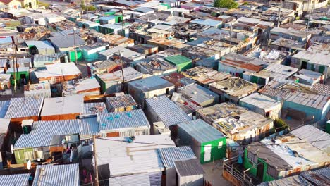 Aerial-over-ramshackle-tin-roofs-of-Gugulethu-one-of-the-poverty-stricken-slums-ghetto-or-townships-of-South-Africa-3