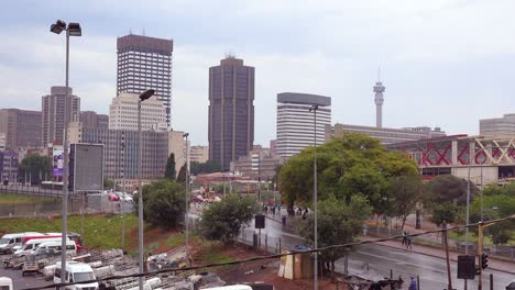 Establishing-shot-of-downtown-business-district-of-Johannesburg-South-Africa-with-tower-and-street-traffic