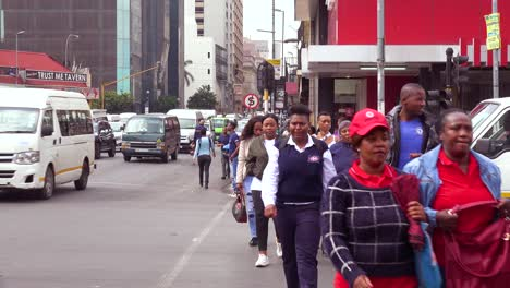 People-walk-on-the-streets-in-the-downtown-business-district-of-Johannesburg-South-Africa