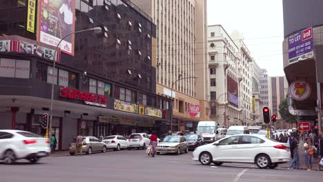 People-walk-on-the-streets-in-the-downtown-business-district-of-Johannesburg-South-Africa-1