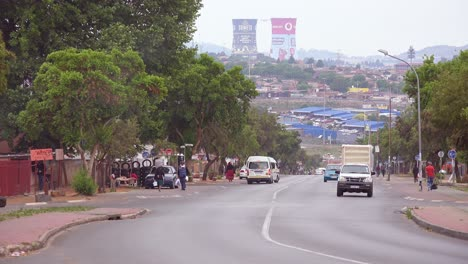 Establishing-shot-of-painted-cooling-towers-in-distance-of-Soweto-township-South-Africa-1