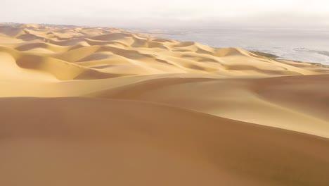Astonishing-aerial-shot-over-the-vast-sand-dunes-of-the-Namib-Desert-along-the-Skeleton-Coast-of-Namibia-1