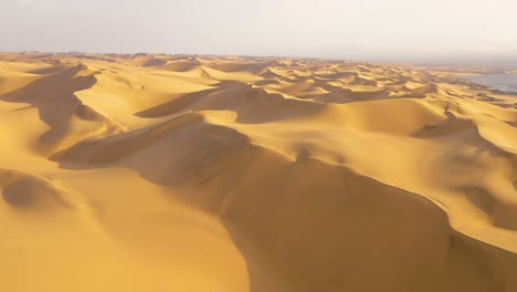 Astonishing-aerial-shot-over-the-vast-sand-dunes-of-the-Namib-Desert-along-the-Skeleton-Coast-of-Namibia-4