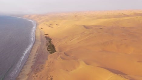 Good-high-aerial-shot-over-the-vast-sand-dunes-of-the-Namib-Desert-along-the-Skeleton-Coast-of-Namibia