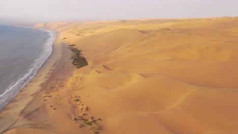 Good-high-aerial-shot-over-the-vast-sand-dunes-of-the-Namib-Desert-along-the-Skeleton-Coast-of-Namibia-1