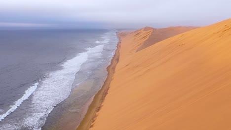 Astonishing-aerial-shot-over-the-vast-sand-dunes-of-the-Namib-Desert-along-the-Skeleton-Coast-of-Namibia-ends-on-safari-van