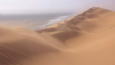 High-winds-blow-across-the-amazing-sand-dunes-of-the-Namib-Desert-along-the-Skeleton-Coast-of-Namibia-1