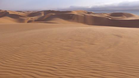 View-across-the-amazing-sand-dunes-of-the-Namib-Desert-along-the-Skeleton-Coast-of-Namibia