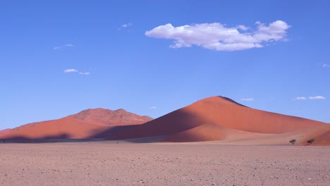 Establishing-shot-of-the-Namib-Naukluft-National-park-with-desert-dunes-and-clouds-Namibia