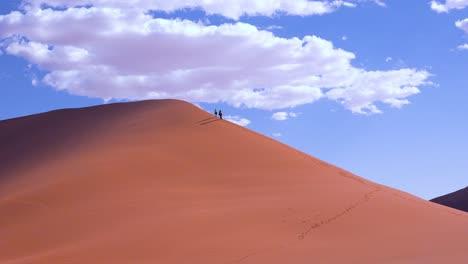 Tourists-climbing-the-steep-sand-dune-45-Namib-Naukluft-national-Park-Namib-desert-namibia