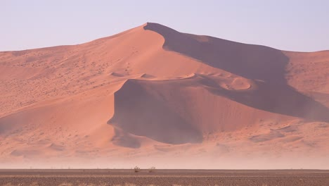 Very-strong-winds-blow-sand-around-dunes-during-a-sandstorm-in-Namib-Naukluft-National-park-Namibia