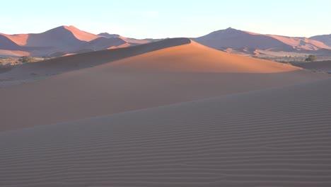 Establishing-shot-of-Namib-Naukluft-National-Park-in-the-Namib-desert-and-massive-sand-dunes-dawn-Namibia