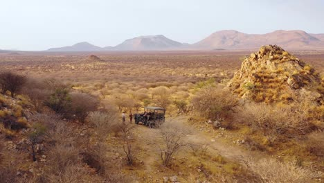 Aerial-of-tourists-enjoying-a-moment-on-a-safari-jeep-at-the-vast-and-beautiful-Erindi-Game-Preserve-Namibia