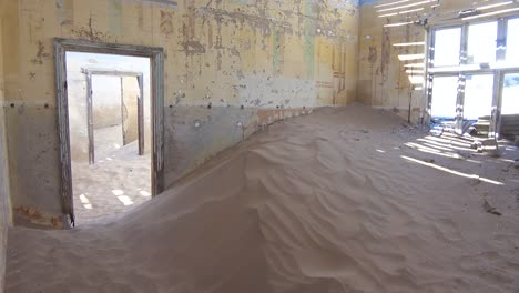 Sand-fills-an-abandoned-building-in-the-gem-mining-ghost-town-of-Kolmanskop-Namibia