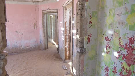 Sand-blows-through-an-abandoned-building-in-the-gem-mining-ghost-town-of-Kolmanskop-Namibia
