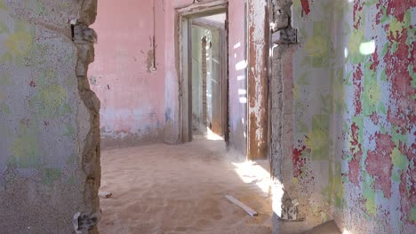 Sand-blows-through-an-abandoned-building-in-the-gem-mining-ghost-town-of-Kolmanskop-Namibia-2