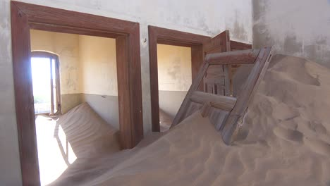 Sand-blows-through-an-abandoned-building-in-the-gem-mining-ghost-town-of-Kolmanskop-Namibia-3