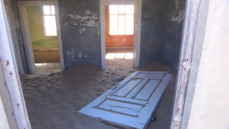 Sand-fills-an-abandoned-building-in-the-gem-mining-ghost-town-of-Kolmanskop-Namibia-1