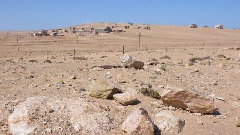 Exterior-establishing-shot-of-abandoned-buildings-in-the-Namib-desert-at-the-ghost-town-of-Kolmanskop-Namibia