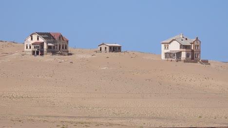 Exterior-establishing-shot-of-abandoned-buildings-in-the-Namib-desert-at-the-ghost-town-of-Kolmanskop-Namibia-2