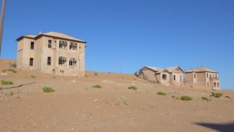 Exterior-establishing-shot-of-abandoned-buildings-in-the-Namib-desert-at-the-ghost-town-of-Kolmanskop-Namibia-3