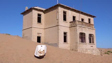 Exterior-establishing-shot-of-abandoned-buildings-in-the-Namib-desert-at-the-ghost-town-of-Kolmanskop-Namibia-4