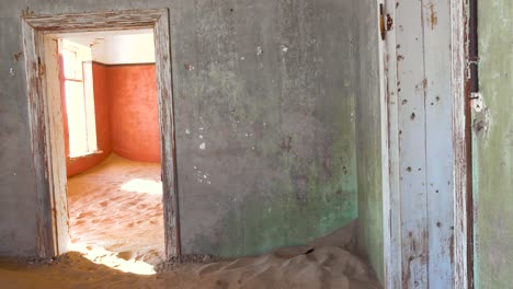 Sand-fills-an-abandoned-building-in-the-gem-mining-ghost-town-of-Kolmanskop-Namibia-4