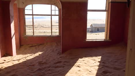 Sand-fills-an-abandoned-building-in-the-gem-mining-ghost-town-of-Kolmanskop-Namibia-5