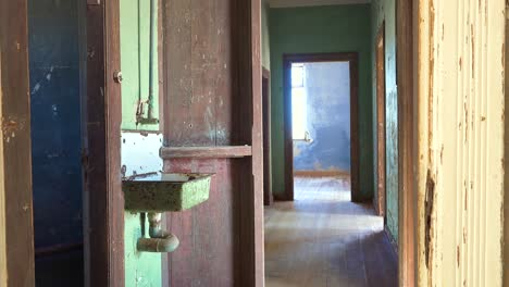 Colorful-walls-of-an-abandoned-building-in-the-gem-mining-ghost-town-of-Kolmanskop-Namibia
