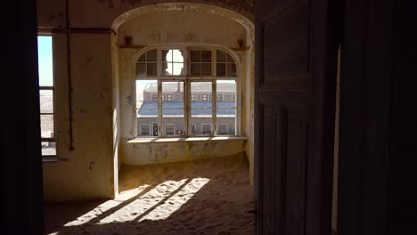 Sand-fills-an-abandoned-building-in-the-gem-mining-ghost-town-of-Kolmanskop-Namibia-6