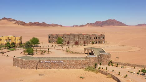 Aerial-of-the-spectacular-Le-Mirage-Resort-lodge-hotel-castle-and-spa-in-the-Sossusvlei-region-of-Namib-Desert-Namibia-