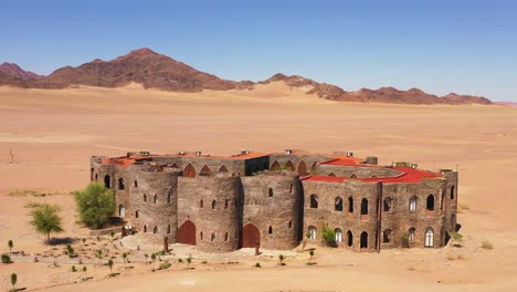 Aerial-of-the-spectacular-Le-Mirage-Resort-lodge-hotel-castle-and-spa-in-the-Sossusvlei-region-of-Namib-Desert-Namibia-1