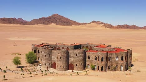 Aerial-of-the-spectacular-Le-Mirage-Resort-lodge-hotel-castle-and-spa-in-the-Sossusvlei-region-of-Namib-Desert-Namibia-4