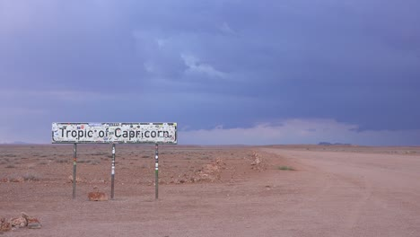 A-sign-along-the-road-in-remote-Namibia-announces-the-Tropic-Of-Capricorn