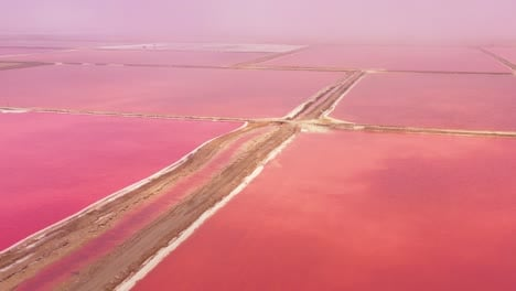 Beautiful-aerial-over-bright-red-and-pink-salt-pan-farms-near-Walvis-Bay-Namibia-3