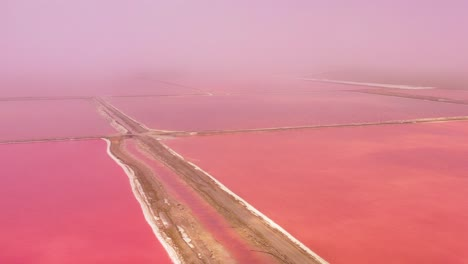 Beautiful-aerial-over-bright-red-and-pink-salt-pan-farms-near-Walvis-Bay-Namibia-4