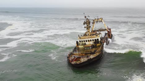 Dramatic-aerial-over-a-spooky-shipwreck-grounded-fishing-trawler-along-the-Skeleton-Coast-of-Namibia-1