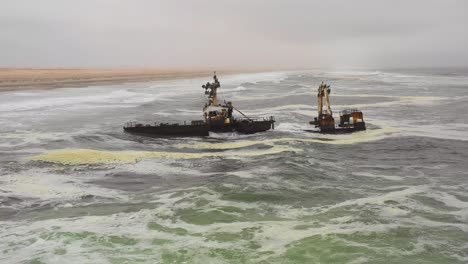 Dramatic-aerial-over-a-spooky-shipwreck-grounded-fishing-trawler-along-the-Skeleton-Coast-of-Namibia-2