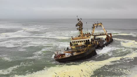 Dramatic-aerial-over-a-spooky-shipwreck-grounded-fishing-trawler-along-the-Skeleton-Coast-of-Namibia-3