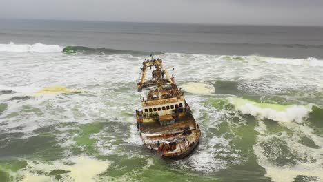 Dramatic-aerial-over-a-spooky-shipwreck-grounded-fishing-trawler-along-the-Skeleton-Coast-of-Namibia-4