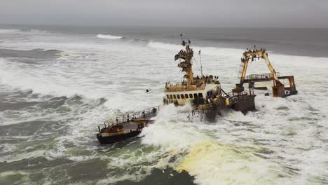 Dramatic-aerial-over-a-spooky-shipwreck-grounded-fishing-trawler-along-the-Skeleton-Coast-of-Namibia-5