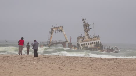A-spooky-shipwreck-grounded-fishing-trawler-sits-in-Atlantic-waves-along-the-Skeleton-Coast-of-Namibia-3