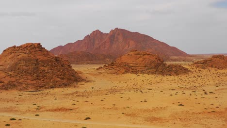 Aerial-over-the-Namib-Desert-and-the-massive-rock-formations-at-Spitzkoppe-Namibia