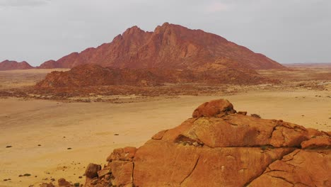 Aerial-over-the-Namib-Desert-and-the-massive-rock-formations-at-Spitzkoppe-Namibia-1
