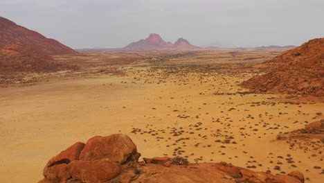 Aerial-over-the-Namib-Desert-and-the-massive-rock-formations-at-Spitzkoppe-Namibia-3